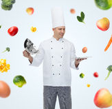 Happy male chef cook opening cloche Royalty Free Stock Photos
