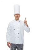 Happy male chef cook pointing finger up Stock Photos