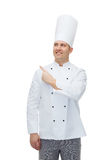 Happy male chef cook pointing finger up Royalty Free Stock Photos