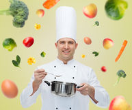 Happy male chef cook with pot and spoon Stock Images