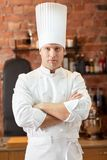 Happy male chef cook in restaurant kitchen Stock Photo