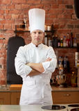 Happy male chef cook in restaurant kitchen Royalty Free Stock Photos