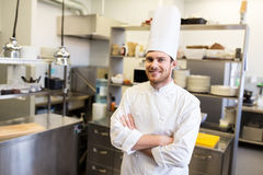 Happy male chef cook at restaurant kitchen Royalty Free Stock Images