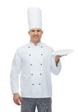 Happy male chef cook showing empty plate Stock Photo