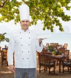 Happy male chef cook showing empty plate Stock Images
