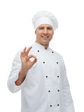 Happy male chef cook showing ok sign Stock Photo