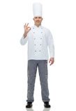 Happy male chef cook showing ok sign Royalty Free Stock Photography