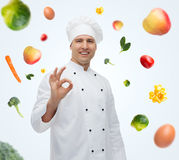 Happy male chef cook showing ok sign Royalty Free Stock Image