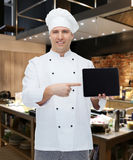 Happy male chef cook showing with tablet pc Royalty Free Stock Photography