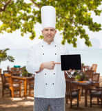 Happy male chef cook showing with tablet pc Stock Photography