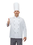 Happy male chef cook showing thumbs up Royalty Free Stock Images