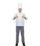Happy male chef cook showing thumbs up Stock Images