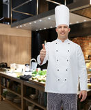 Happy male chef cook showing thumbs up Stock Image