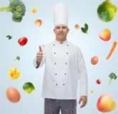 Happy male chef cook showing thumbs up Royalty Free Stock Photography