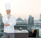 Happy male chef cook thinking Royalty Free Stock Image