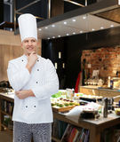 Happy male chef cook thinking Royalty Free Stock Images