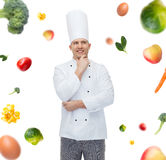 Happy male chef cook thinking Royalty Free Stock Photography