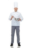 Happy male chef cook whipping something with whisk Royalty Free Stock Photos