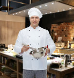 Happy male chef cook whipping something with whisk Stock Images
