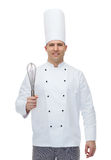 Happy male chef cook with whisk Royalty Free Stock Image
