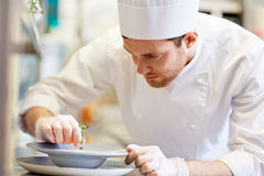 Happy male chef cooking food at restaurant kitchen Royalty Free Stock Photography