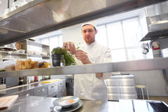 Happy male chef cooking at restaurant kitchen Royalty Free Stock Image