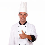 Happy male chef with positive thumb Royalty Free Stock Photos