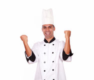 Happy male chef showing winning gesture with hands Royalty Free Stock Image