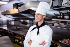 Happy male chef standing with arms crossed Royalty Free Stock Photos