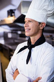 Happy male chef standing with arms crossed Stock Photo