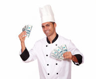 Happy male in chef uniform holding cash money Royalty Free Stock Photo