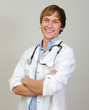 Happy male doctor stock image