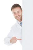 Happy male doctor displaying billboard Stock Images