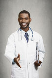 Happy male doctor giving handshake to his patient. Closeup portrait smiling healthcare professional, male doctor with stethoscope, holding clipboard giving Royalty Free Stock Images