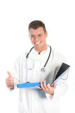 Happy male doctor giving a thumbs up Royalty Free Stock Images