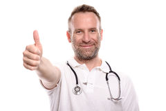 Happy male doctor giving a thumbs up gesture Royalty Free Stock Photography
