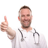 Happy male doctor giving a thumbs up gesture Royalty Free Stock Photos
