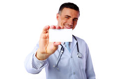 Happy male doctor holding blank card Royalty Free Stock Images