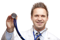 Happy male doctor holding stethoscope Stock Images