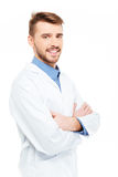 Happy male doctor standing with arms folded Stock Photos