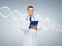 Happy male doctor with tablet pc and dna molecule. Healthcare, technology, genetics, people and medicine concept - smiling male doctor in white coat with tablet royalty free stock photography