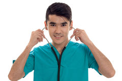 Happy male doctor in uniform with stethoscope on his neck smiling on camera isolated on white background Stock Photos