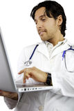 Happy male doctor working with laptop Stock Photo