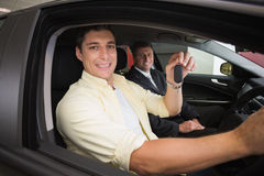 Happy male driver at the wheel sitting in his car Stock Images