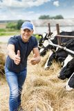 Happy farmer among cows. Happy male farmer among cows stock photo