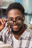 Happy male fashion designer holding eye glasses Royalty Free Stock Image
