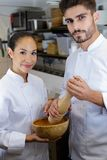 Happy male and female chef royalty free stock images