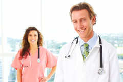 Happy Male and Female Doctors Stock Photography