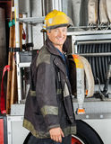Happy Male Firefighter Standing By Truck Royalty Free Stock Photos