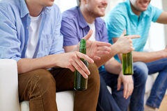 Happy male friends with beer watching tv at home Royalty Free Stock Photo